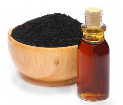 nigella-sativa-black-cumin-essential-oil-over-white-background-36177045 copy